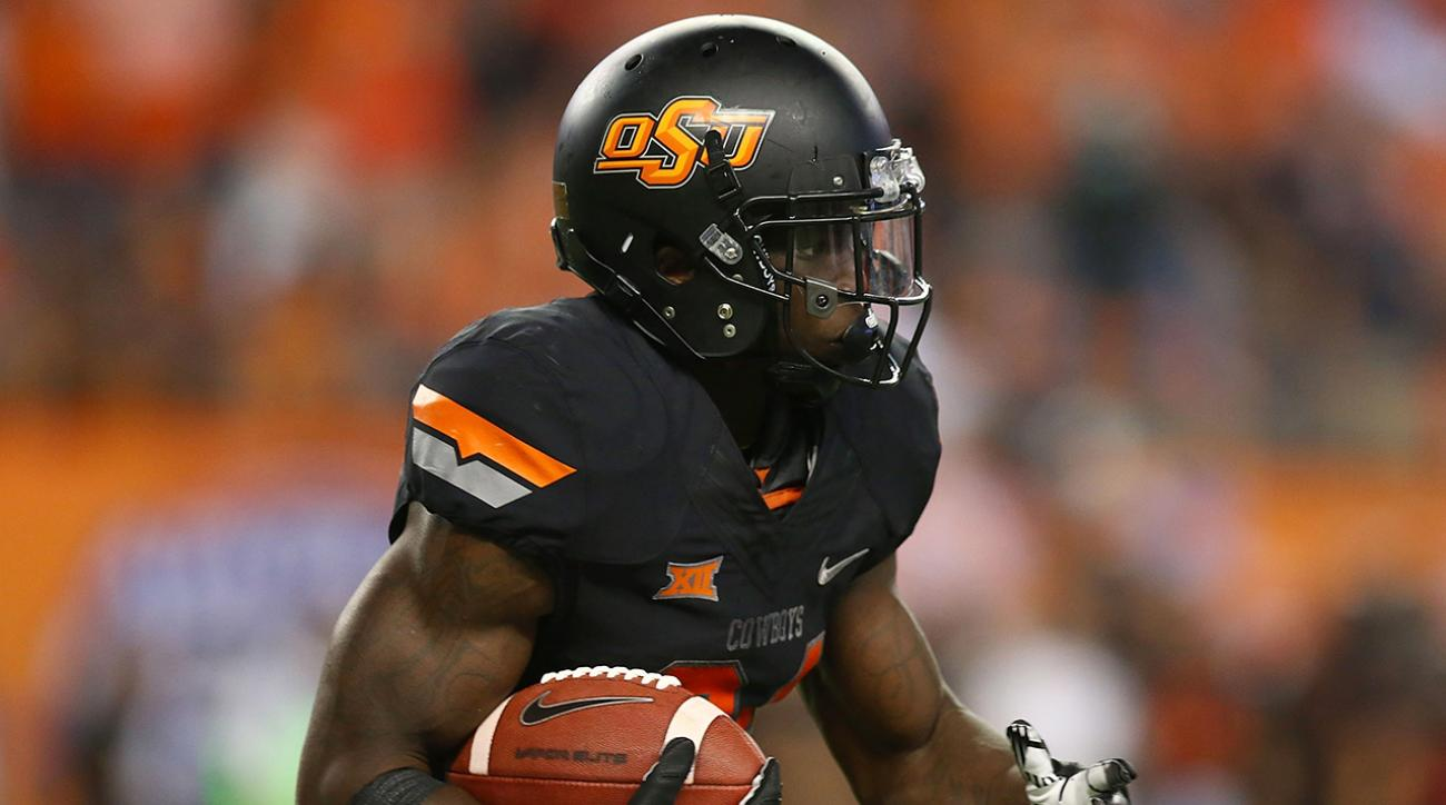 oklahoma state tyreek hill arrested domestic assault