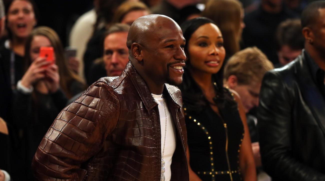 Mayweather denies fight set with Pacquiao on live TV