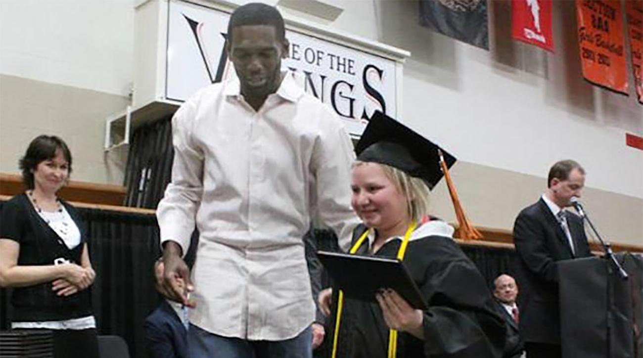 Randy Moss attends graduation of leukemia survivor and long time fan