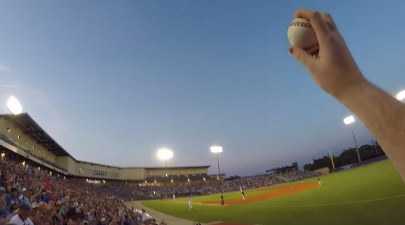 Watch a fan barehand a line drive foul ball while wearing GoPro