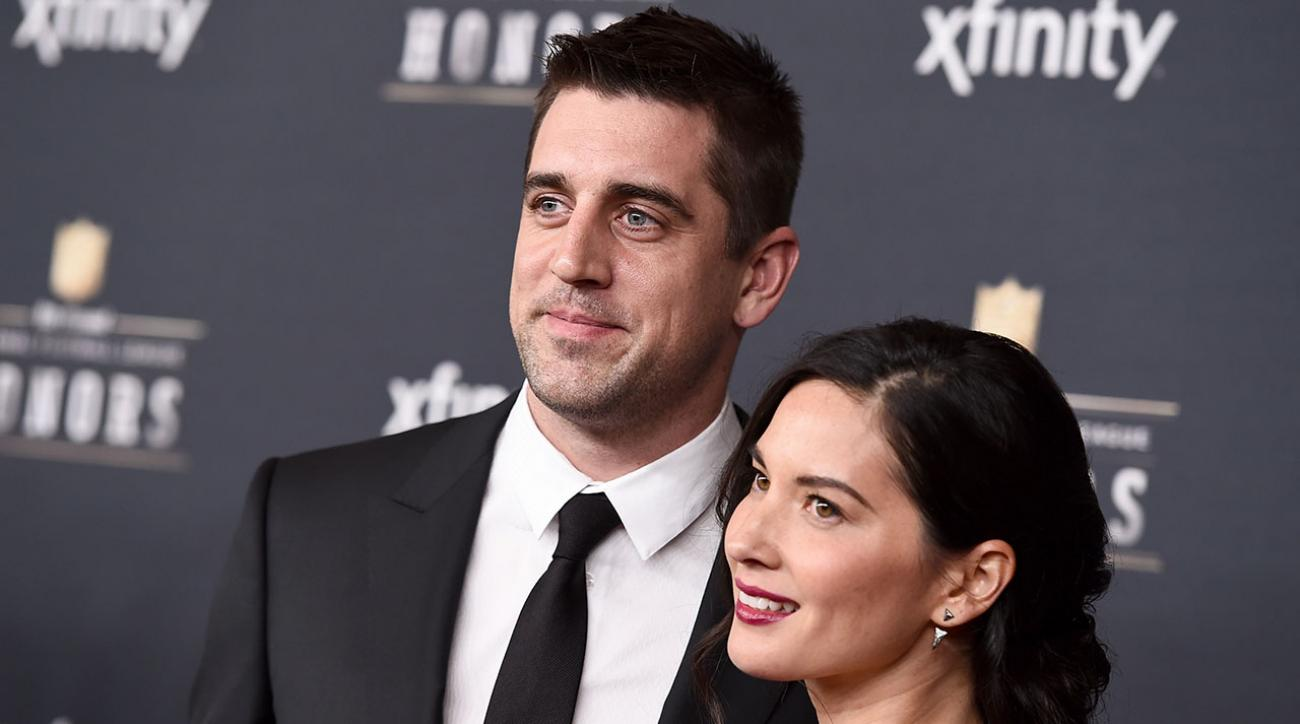 Packers' Aaron Rodgers sword fighting with Olivia Munn