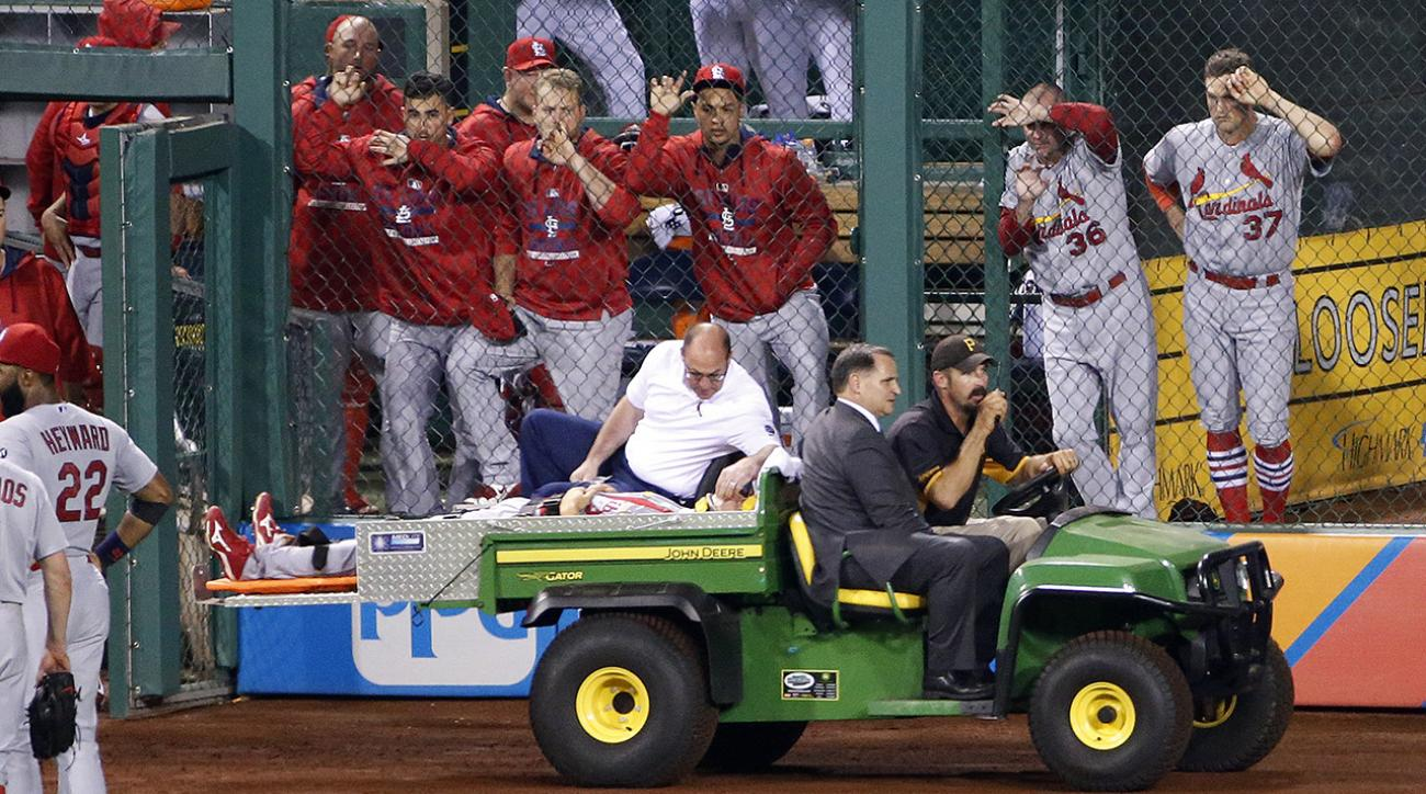 Cardinals' outfielder Stephen Piscotty taken off on stretcher after collision IMAGE