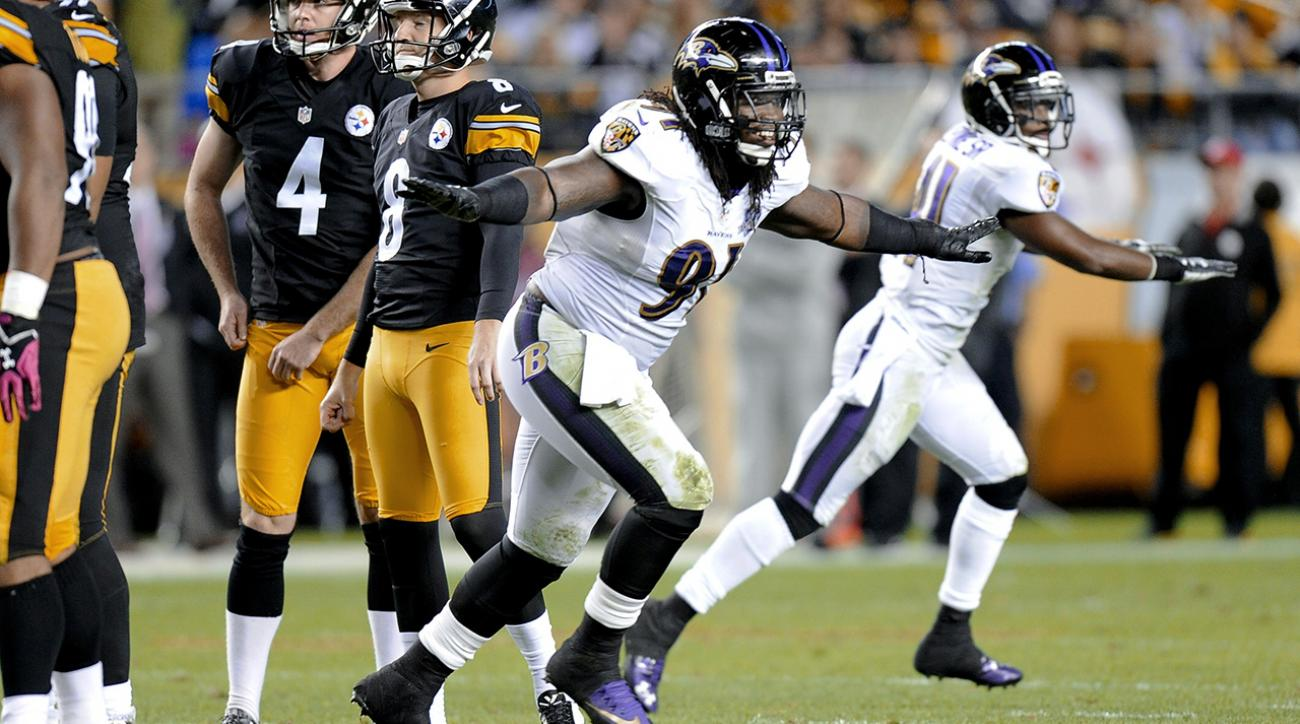 Michael Vick, Steelers handed loss by Ravens in OT IMAGE