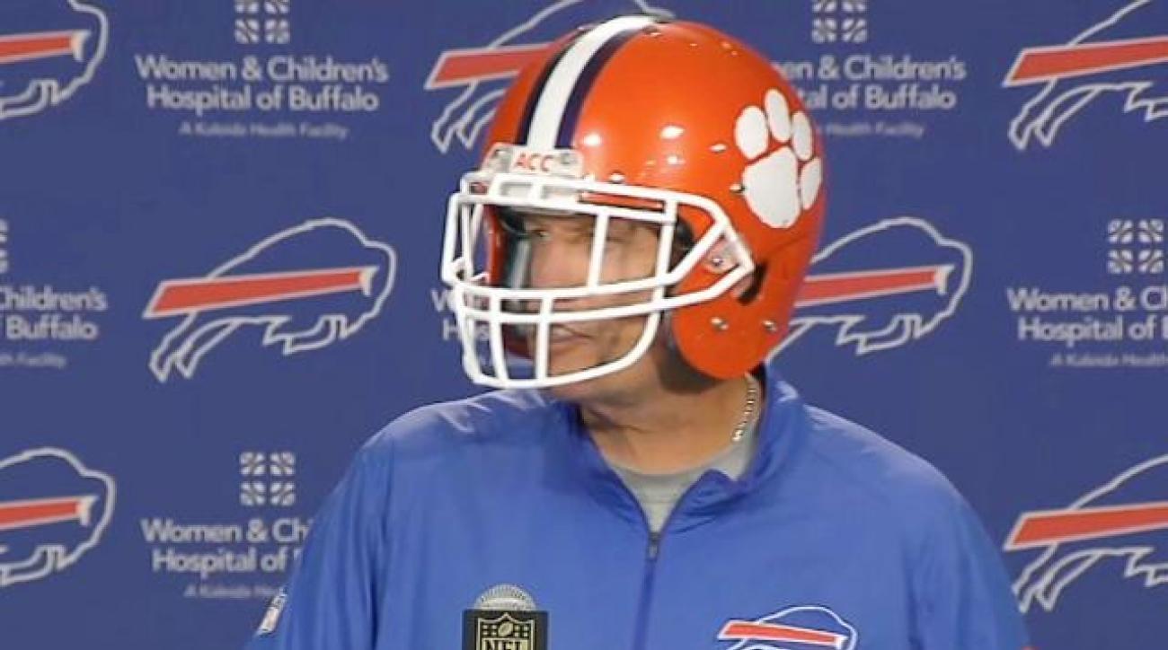 Rex Ryan wears a Clemson helmet to a press conference