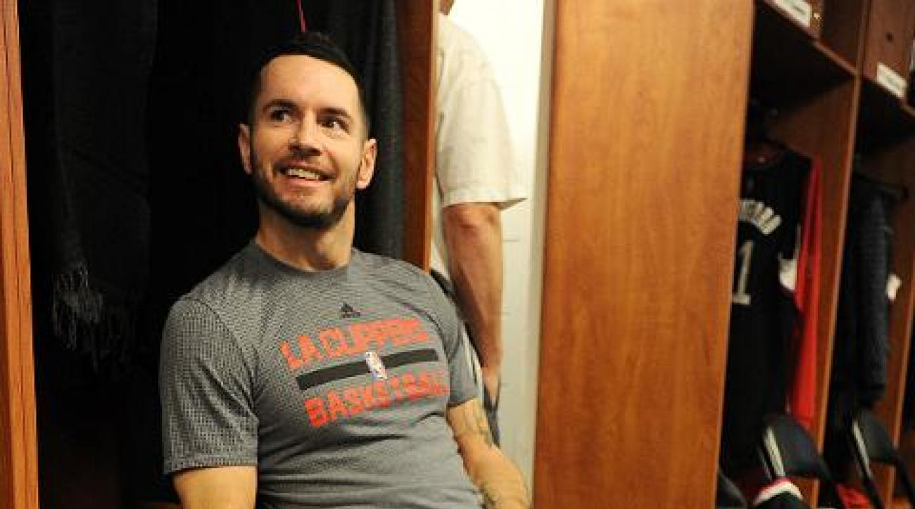 Clippers' J.J. Redick sprints away from postgame interview