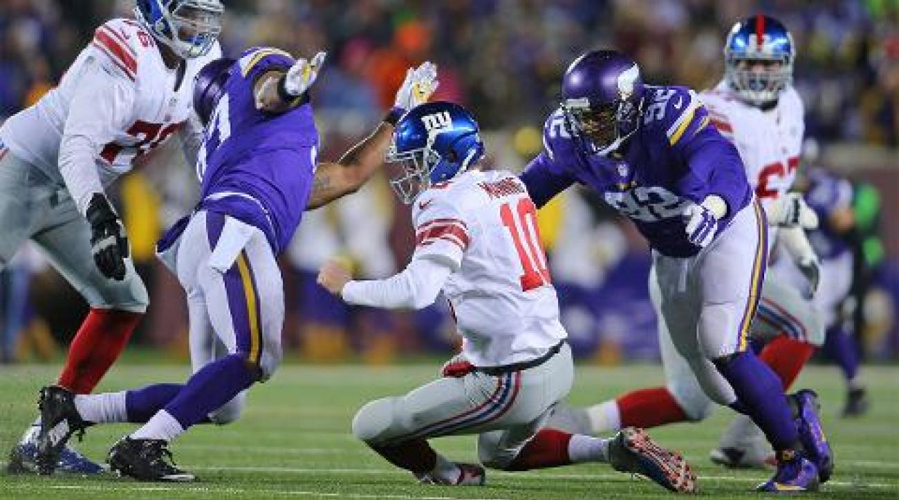 Vikings roll Giants 49-17, clinch playoff berth