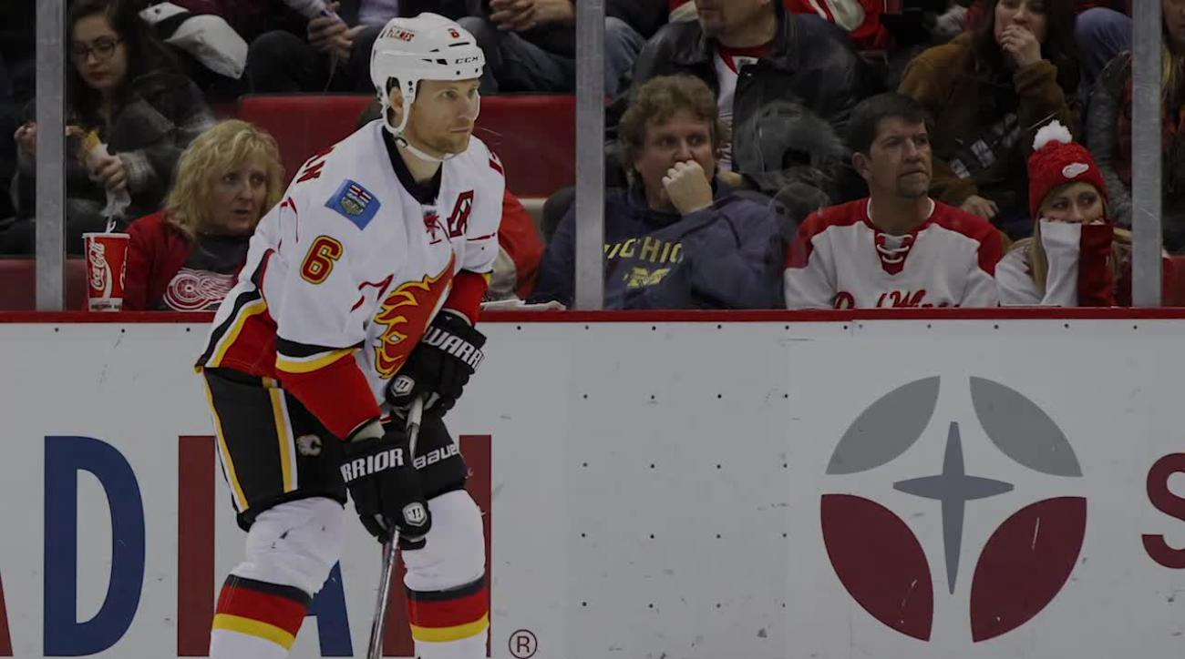Flames' Dennis Wideman suspended indefinitely, awaits hearing