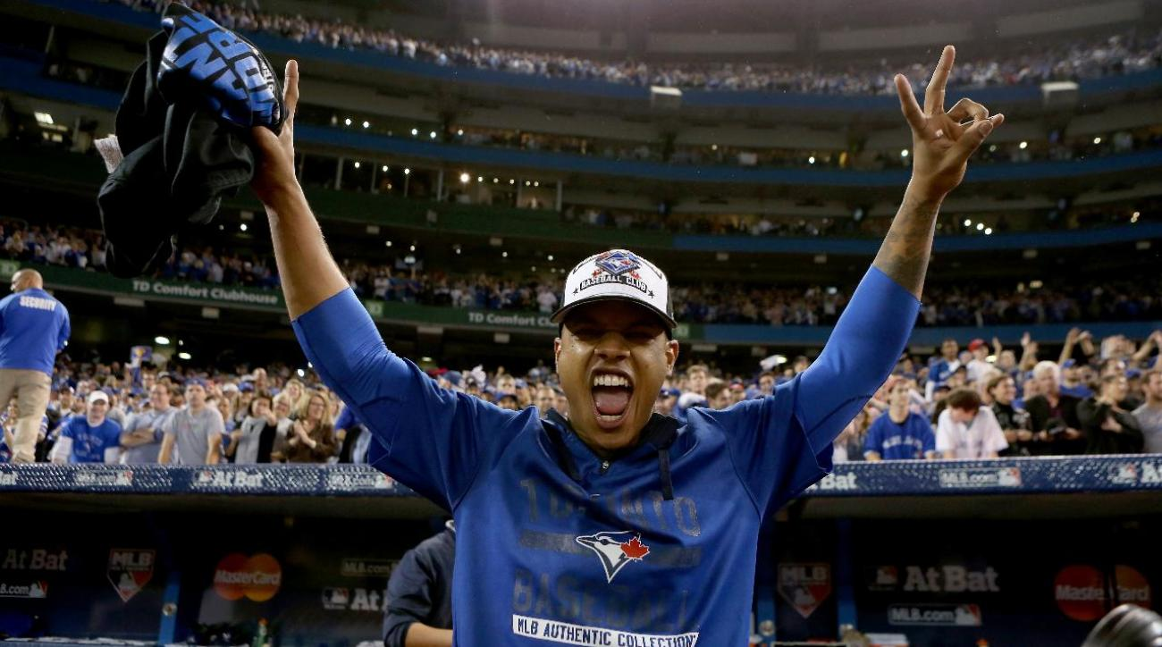 Blue Jays pitcher Marcus Stroman walks at Duke graduation