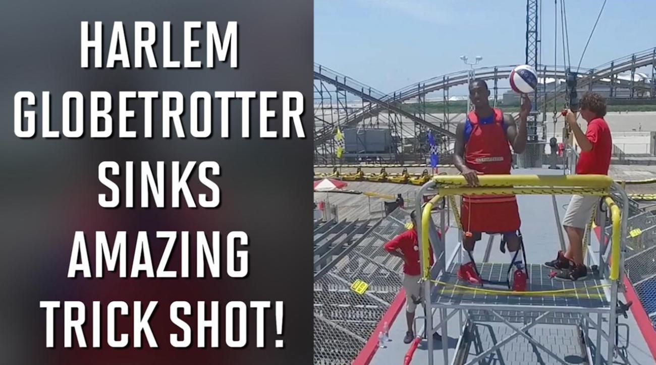 Harlem Globetrotter sinks amazing trick shot