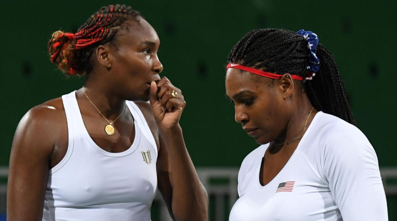 Williams sisters eliminated in first-round Olympic doubles match