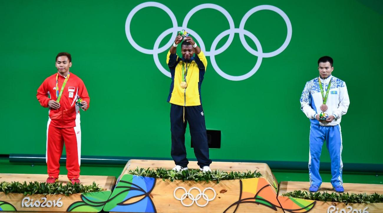 Colombian weightlifter wins gold, then retires