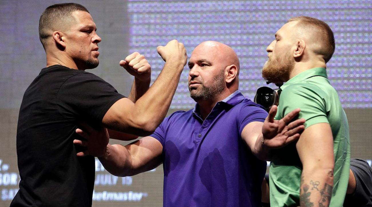 Watch Conor McGregor, Nate Diaz throw water bottles at each other IMAGE