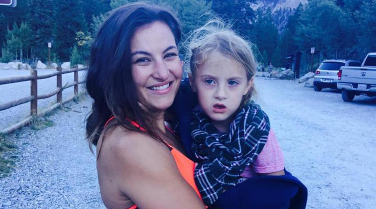 MMA fighter Miesha Tate carries injured six-year-old down mountain