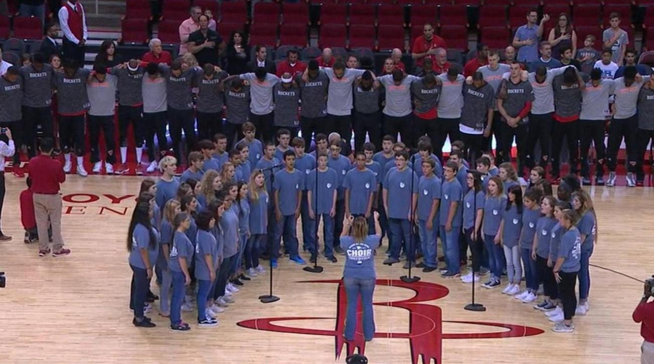 Knicks, Rockets stand together during national anthem