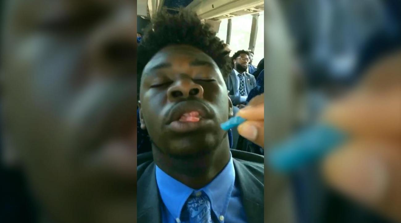 Clemson players feed sleeping teammates Sour Patch Kids
