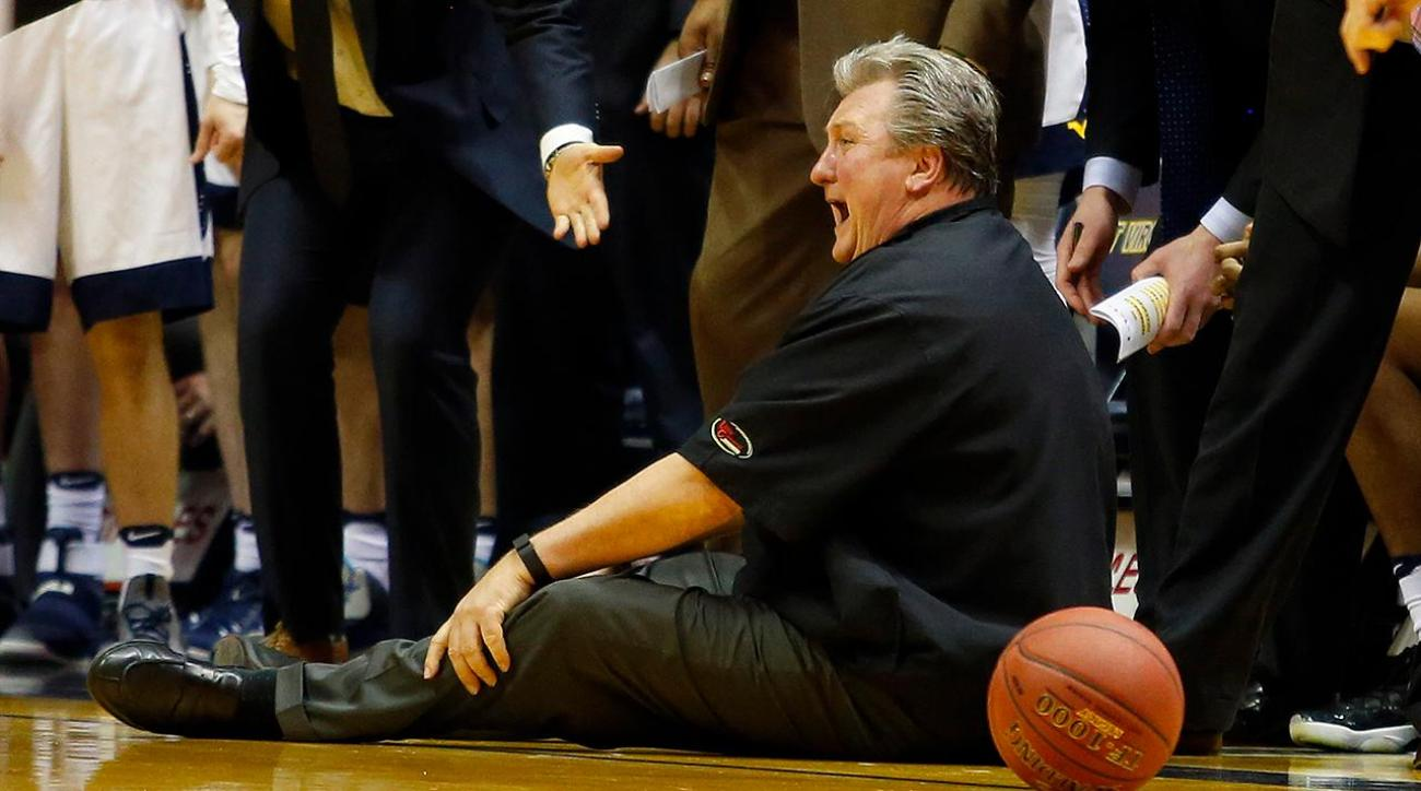 WVU's Huggins falls in apparent health scare, stays on bench IMAGE