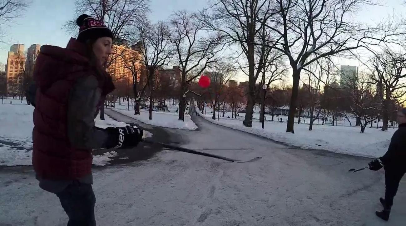 Hilary Knight stickhandles through the streets of Boston