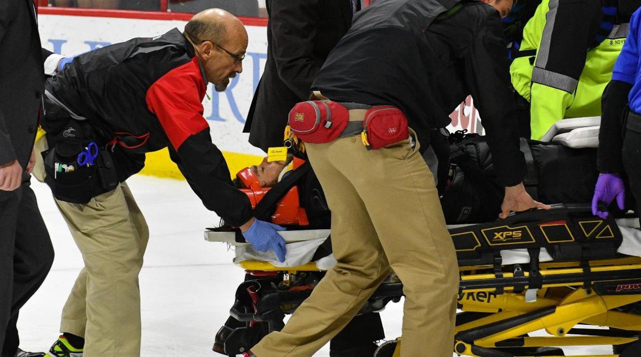 Hurricanes goalie Eddie Lack taken from ice on stretcher after collision