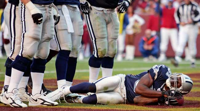 After scoring a touchdown, Terrell Owens pretends to nap with the football during a Cowboys game in November 2006. Now sleeping has become part of the job.