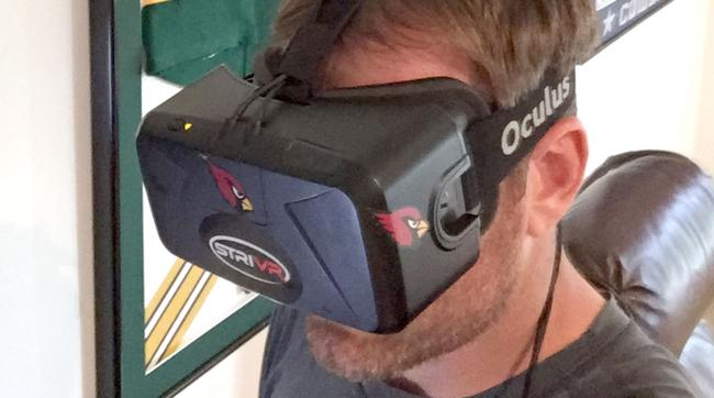 Carson Palmer uses the virtual reality headset to review formations and scout-team tendencies from practice, and to tweak his own mechanics.