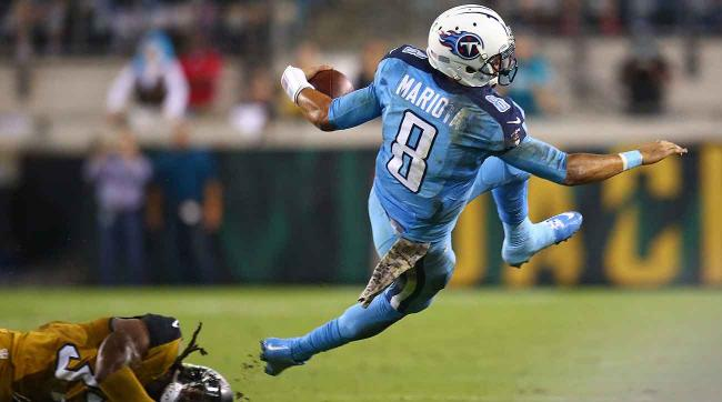 Marcus Mariota was hit often as a rookie; the Titans allowed the most sacks in NFL.