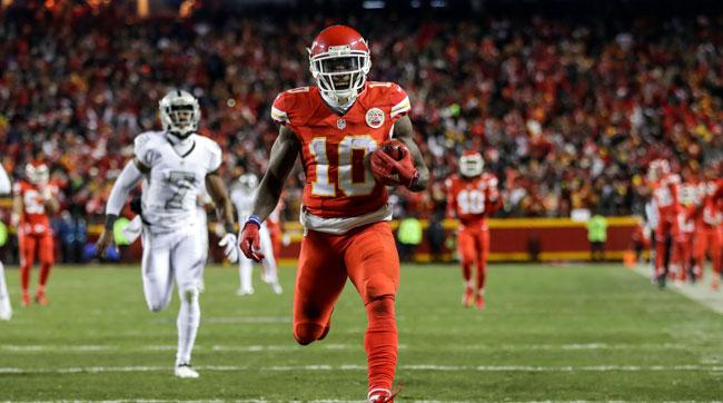 Tyreek Hill returns a punt for a touchdwon against the Raiders in early December.