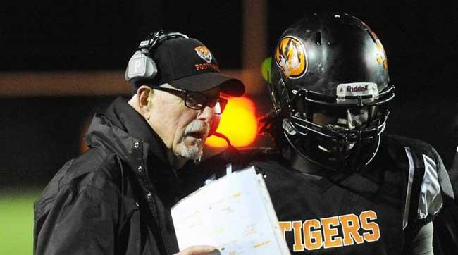 Eliott Uzelac, a former assistant to Bill Belichick and Bo Schembechler, led Michigan's Benton Harbor High to the first playoff win in school history last Friday night.