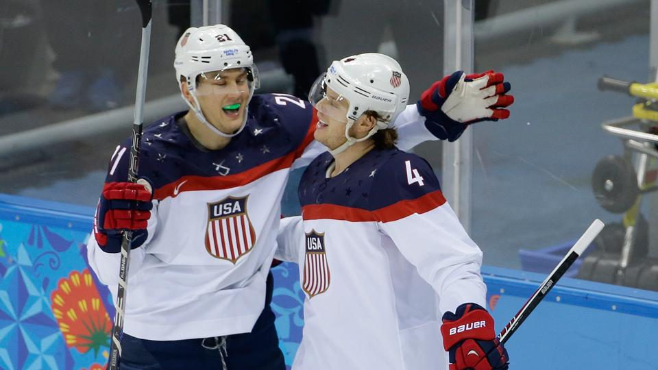 USA defenseman John Carlson, right, and forward James van Riemsdyk will look to top host Russia in their much-anticipated game Saturday in Sochi.