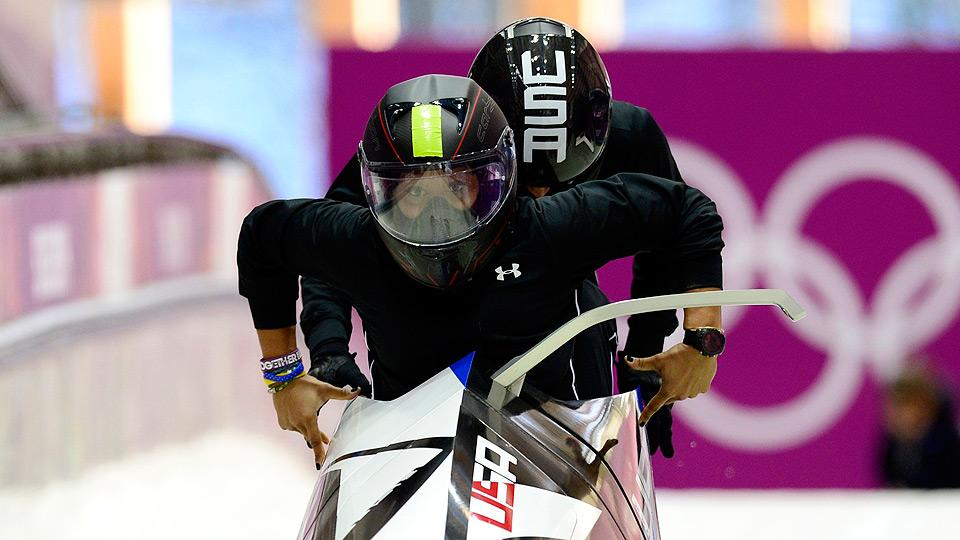 Lolo Jones jumps in behind driver Jazmine Fenlator during their bobsled training last week.