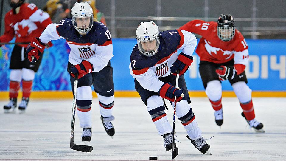 Twins Jocelyne (left) and Monique Lamoureux race down the ice during the U.S.' preliminary game against Canada.