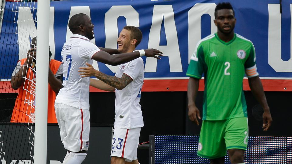 Jozy Altidore, left, celebrates with Fabian Johnson after opening the scoring for the USA against Nigeria.