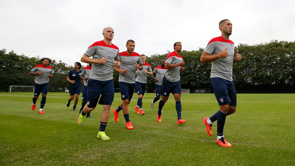 Clint Dempsey, right, and Michael Bradley, left, lead jogging as the U.S. trains for the first time after arriving in Brazil for the World Cup.