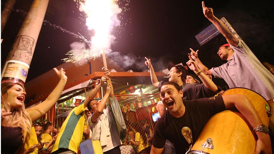 Brazil fans in Sao Paulo's Vila Madalena light fireworks and sing in celebration after the host nation's 3-1 win over Croatia to open the World Cup.