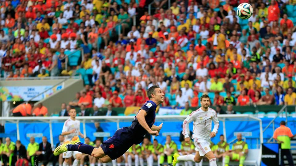 Robin van Persie watches his diving header beat goalkeeper Iker Casillas for an equalizer at the end of the first half between the Netherlands and Spain.