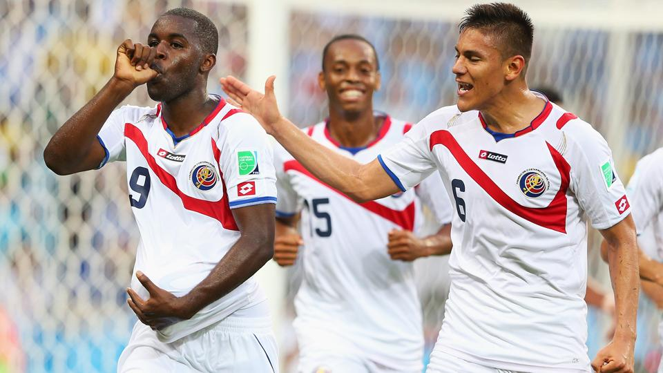 Costa Rica's Joel Campbell, left, celebrates after his goal in Los Ticos' 3-1 win over Uruguay on Saturday.