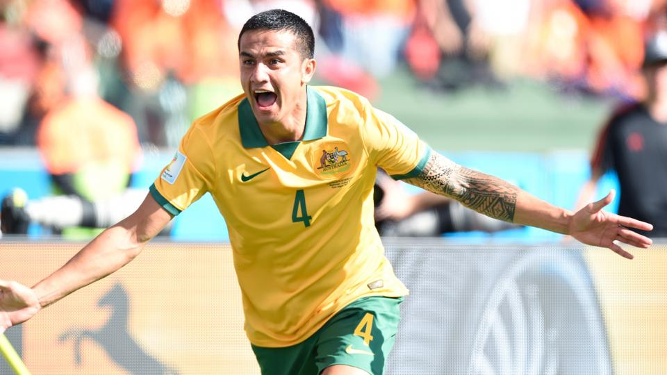 Tim Cahill celebrates after scoring a wondrous goal in Australia's clash with the Netherlands.