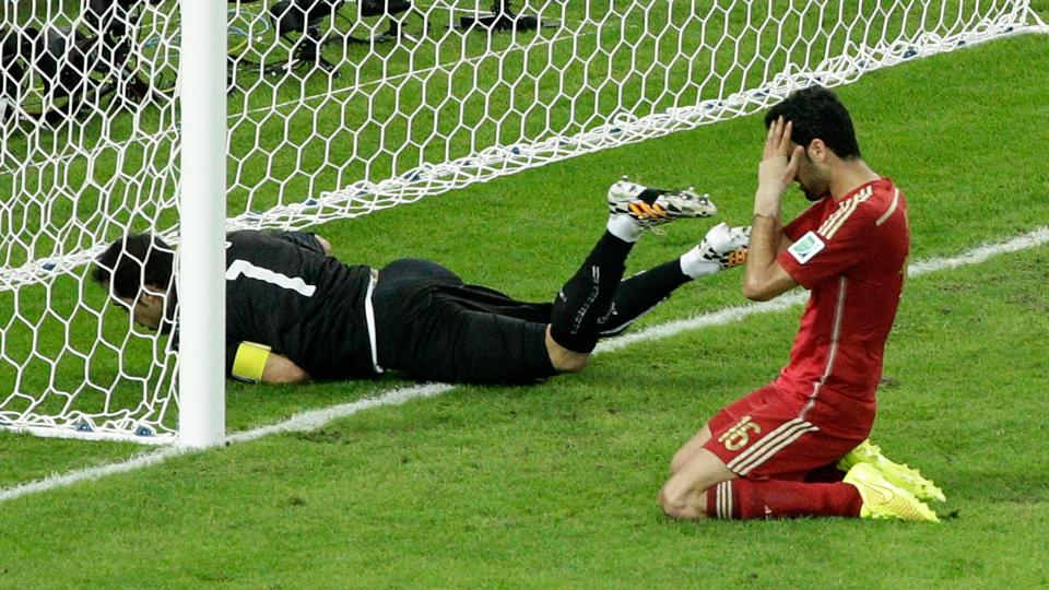 Spain's Sergio Busquets holds his head in shame after failing to turn home a sitter in the second half of a 2-0 loss to Chile.