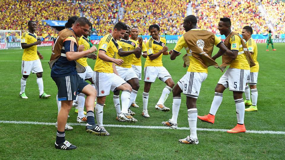 Colombia players dance in celebration after James Rodriguez's opening goal in the 2-1 win over the Ivory Coast on Thursday.