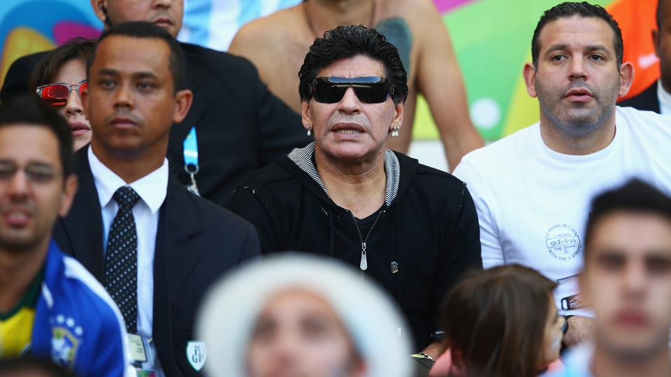 Former Argentina star and manager Diego Maradona, center in sunglasses, was a spectator for Saturday's 1-0 win over Iran.