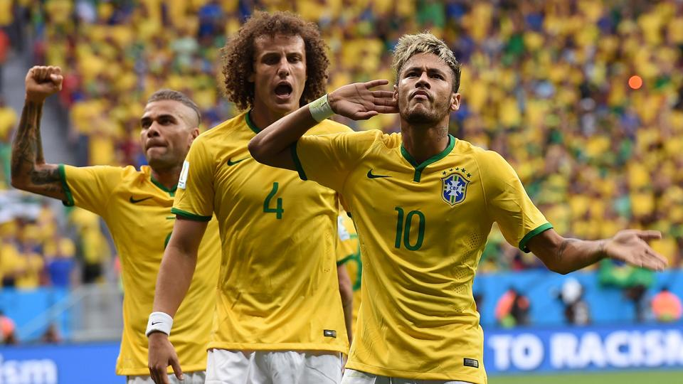 Neymar (10) soaks in the cheers after scoring against Cameroon, helping the host nation cement its place in the knockout stage.