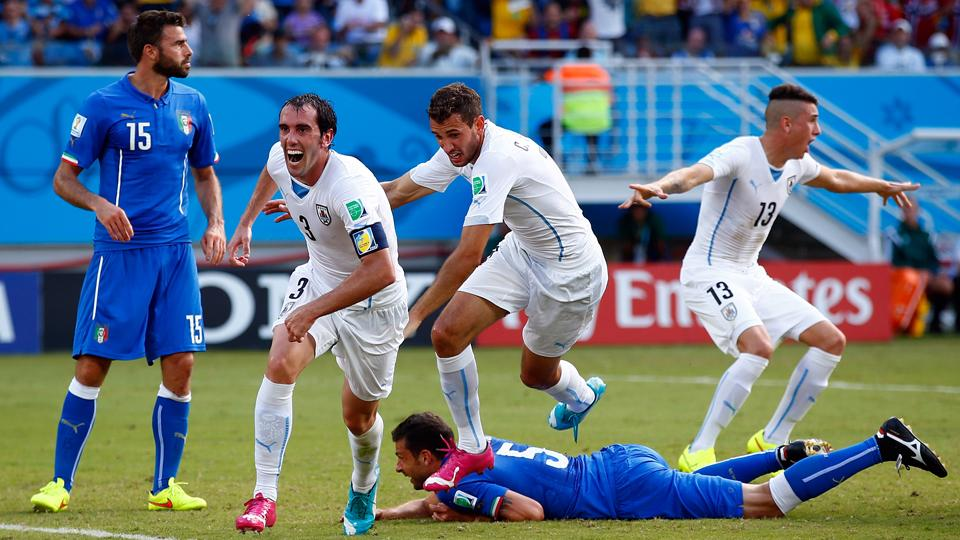 Diego Godin, second from left, celebrates his game-winning goal for Uruguay against Italy.