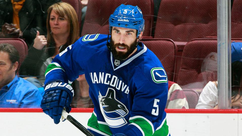 Jason Garrison was traded by the Canucks to the Tampa Bay Lightning on Friday