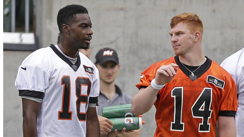 Cincinnati Bengals quarterback Andy Dalton chats with wide receiver A.J. Green during the team's minicamp.