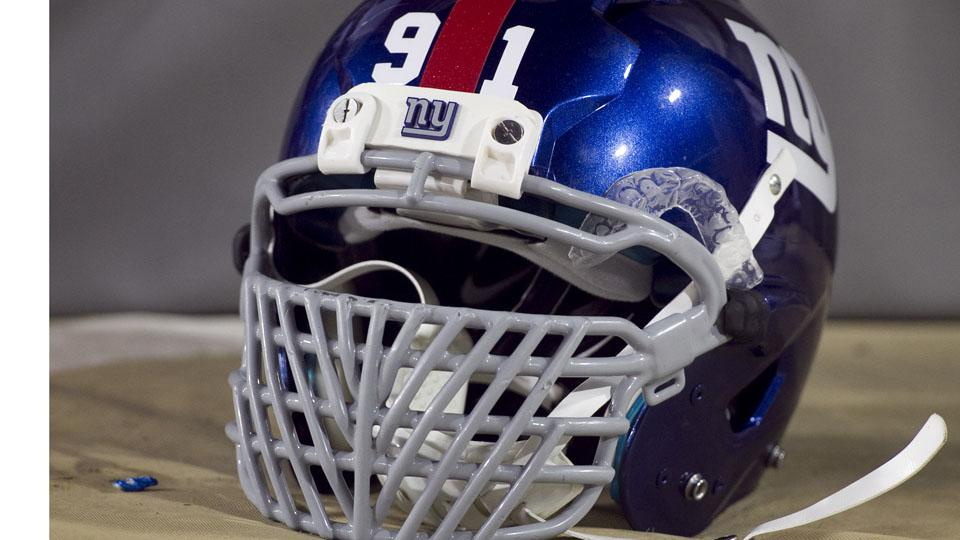 NFL facemasks like this one worn by former New York Giants defensive end Justin Tuck are now illegal.