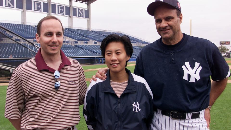 Kim Ng, pictured here in 2000 with the Yankees GM Brian Cashman and manager Joe Torre, is a former assistant GM with the Dodgers and Yankees.