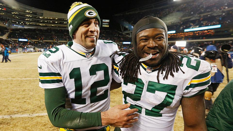 Aaron Rodgers (left) could surpass Peyton Manning in the MVP race with a bounceback year, while Eddie Lacy remains a dark horse among running backs.
