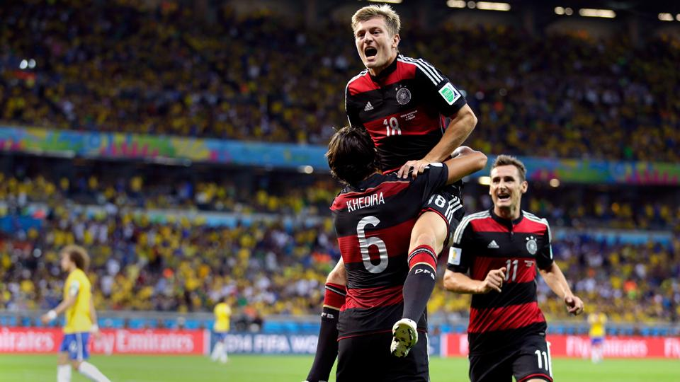 Sami Khedira hoists Toni Kroos after one of the latter's two goals during a five-goal blitz in the first half of Germany's 7-1 World Cup semifinal trouncing of Brazil.