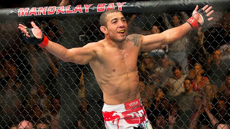 Jose Aldo celebrates his unanimous decision victory over Frankie Edgar just after their 2013 UFC 156 featherweight title match.