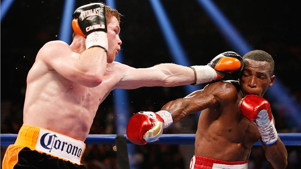 While SI.com scored the fight a draw, Canelo Alvarez (left) pulled out a split decision win against a talented Erislandy Lara (right).