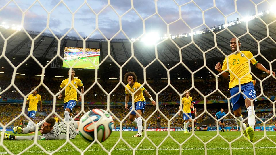 Brazil players watch one of seven German shots hit the back of their net during a humiliating World Cup semifinal defeat.
